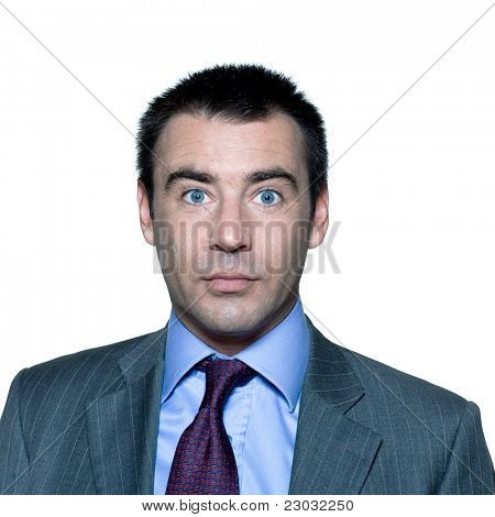 Closeup portrait of a shocked handsome mature man with wide open eyes in studio on isolated white background