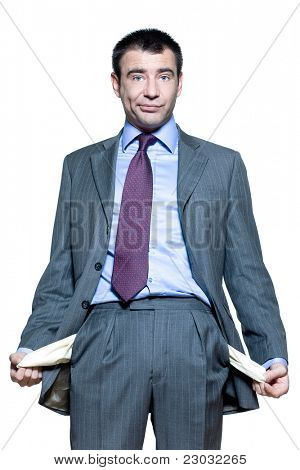 Portrait of an expressive businessman showing his empty pockets isolated on white background