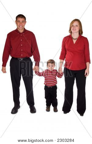 Expecting Parents Standing With Toddler Boy