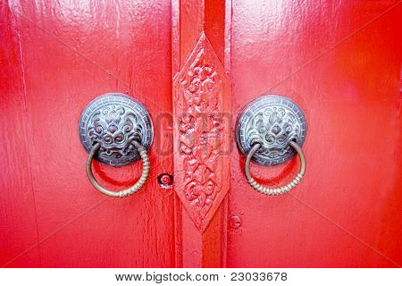 Old thai latch with red door