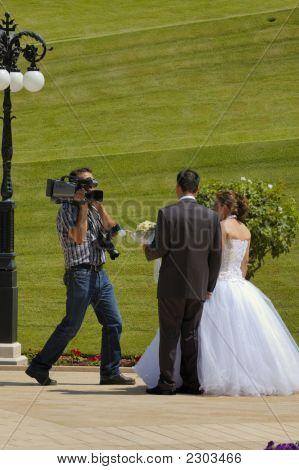 Wedding Couple And Cameraman