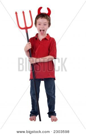 Young Boy In A Devil Costume