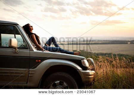 Woman Is Laying On The Car's Hood