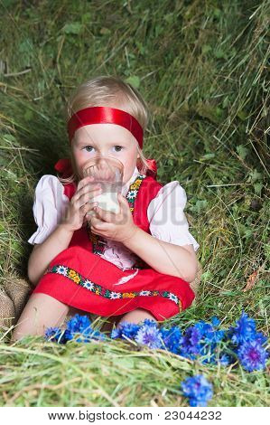 The Little Girl With A Milk Glass On Hay