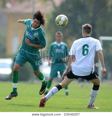 KAPOSVAR, HUNGARY - AUGUST 27: Valentin Hadaro (L) in action at the Hungarian National Championship under 18 game between Kaposvar (green) and Gyor (white) August 27, 2011 in Kaposvar, Hungary.