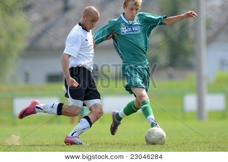 KAPOSVAR, HUNGARY - AUGUST 27: Krisztian Nagy (R) in action at the Hungarian National Championship under 18 game between Kaposvar (green) and Gyor (white) August 27, 2011 in Kaposvar, Hungary.