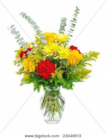 Colorful flower arrangement centerpiece in glass vase with roses, lilies and carnations