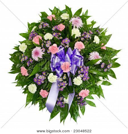 Colorful flower arrangement wreath for funerals isolated on white
