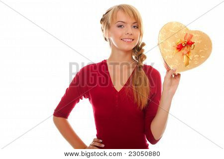 Young Woman Holds In Hand Gold Gift Box As Heart