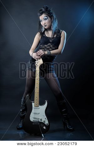 Woman Rockstar With Guitar
