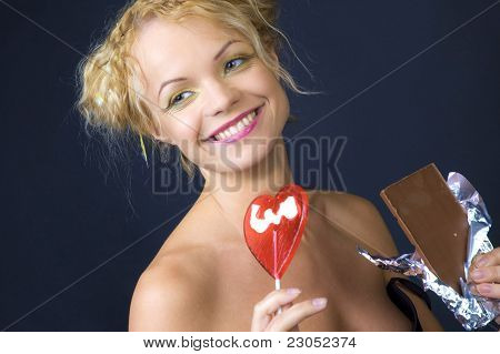 Beauty girl with candy and chocolate
