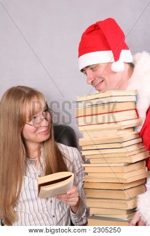 Santa Claus With A Lot Of Books And Blonde