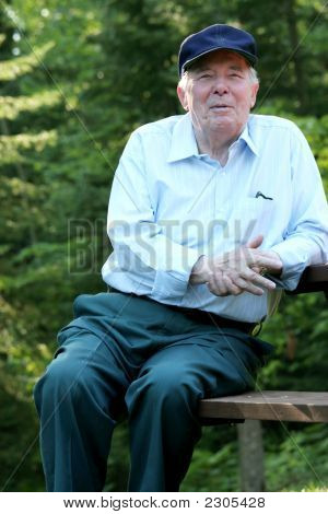 Elderly Man Enjoying A Nice Summer Day Outdoors