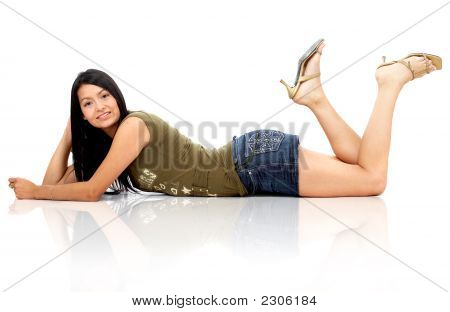 Beautiful Fashion Girl Lying On The Floor