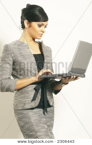 Brunette Business Woman With Laptop
