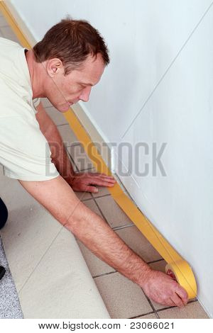 Man at home preparing to lay new flooring