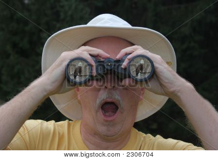 Bird Watcher Looking At A Bald Eagle