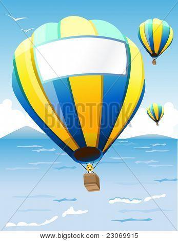 Hot Air Balloons floating at sea coast
