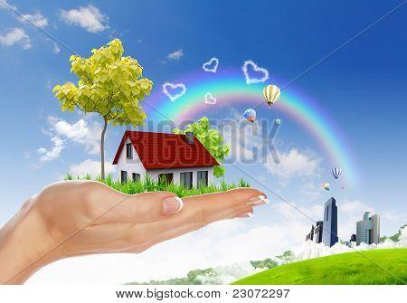 Human hand holding houses
