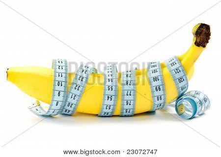 Bananas wrapped with measuring tape.