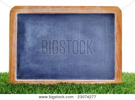 a blank blackboard on the grass to insert such as soccer matches or scores