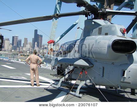 Civilians Inspect An Ah-1W Super Cobra Helicopter