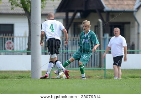 KAPOSVAR, HUNGARY - AUGUST 27: Krisztian Nagy ( in green) in action at the Hungarian National Championship under 18 game between Kaposvar (green) and Gyor (white) August 27, 2011 in Kaposvar, Hungary.