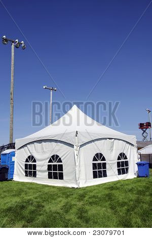 White Tent On Grass Vertical