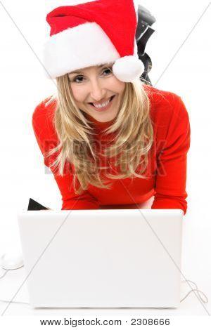 Menina de Natal no Laptop