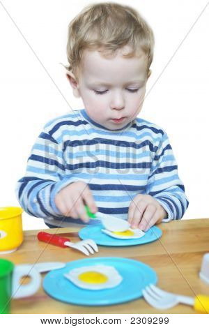 Little Boy Playing With Toy Kitchen