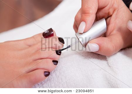 Beautician working on toenails