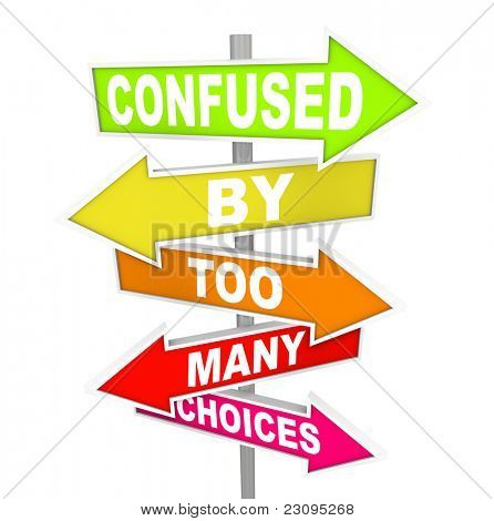 Several colorful arrow street signs with the words Confused By Too Many Choices, illustrating the paralysis and immobility you can feel when suddenly facing a wide array of options to choose from