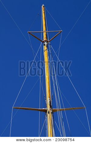 Masthead Wooden Mast Against Blue Sky Rigging Spreaders