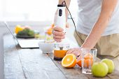 Orange Juice. Selective Focus Of Home Friendly User Orange Fresh Machine Using By Male Hands While O poster