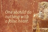 One Should Do Nothing With A False Heart - Ancient Egyptian Proverb Printed On Red Grunge Wall poster