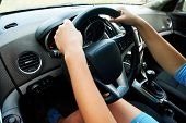 Close Up Of Steering Wheel In Female Driver Hands, Copy Space. Young Womans Hands Holding Steering  poster