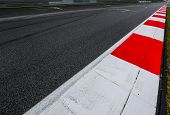 Asphalt Red And White Kerb Of A Race Track Detail poster