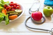 Diet And Weight Loss For Healthy Care With Medical Stethoscope, Fitness Equipment, Vegetable Salad A poster