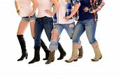 stock photo of lady boots  - Four Sets of ladies country western legs in cowboy boots line dancing - JPG