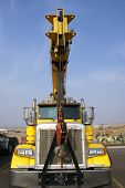 foto of boom-truck  - A flat bed truck with a crane boom to assist with loading freight - JPG