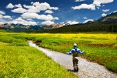 image of fly rod  - A man fly fishing in the summer in Colorado - JPG