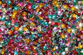 stock photo of glitz  - heaps of rhinestones sparkling in the sunshine - JPG