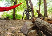 Bicycle And Hammock On The Background Of Camping And Scaffolding poster