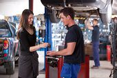 picture of lifting-off  - A happy customer delivering a car to a auto repair shop - JPG