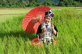 pic of hmong  - Portrait Hmong from Laos with parasol and traditional national costume - JPG
