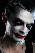 pic of joker  - Spooky man joker on the black background - JPG
