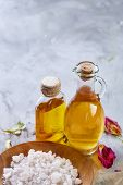 Spa Concept: Composition Of Spa Treatment With Natural Sea Salt, Aromatic Oil And Flowers On Light B poster