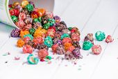 Brightly Colored Candied Popcorn, White Background. Horizontal Image Of Junk Food, Fruit Flavored Po poster