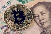 Bitcoin Crypto Currency Banned In China Concept, Closed Up Shot Of Golden Physical Coin With B Sign  poster