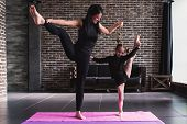 Happy Mother And Daughter Wearing Black Sportswear Having Fun While Doing Leg Stretching Exercise St poster
